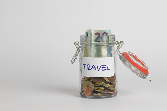 Travel money savings in a glass jar